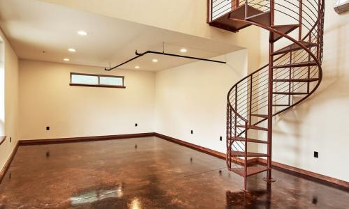 Interior of office building with spiral staircase leading to upstairs loft